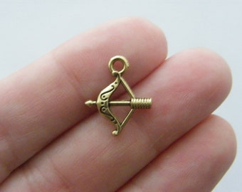 12 Bow and arrow charms gold tone GC3