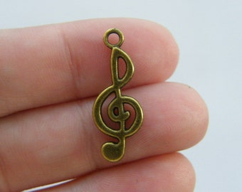 10 Music note charms antique bronze tone BC21