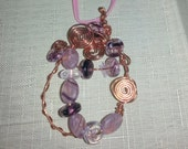 Copper wire wrapped glass burgundy beads set on pink leather string