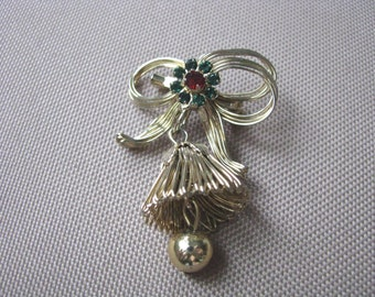 Vintage gold tone holiday bow brooch pin with bell dangle & rhinestones
