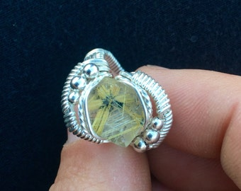 Star rutilated quartz ring wrapped in sterling silver.