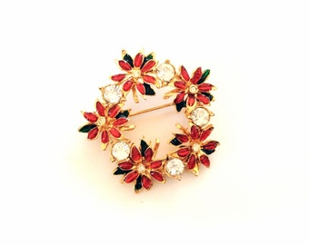 Christmas wreath of poinsettia flowers pin brooch red enamel and rhinestones over gold tone holiday jewelry
