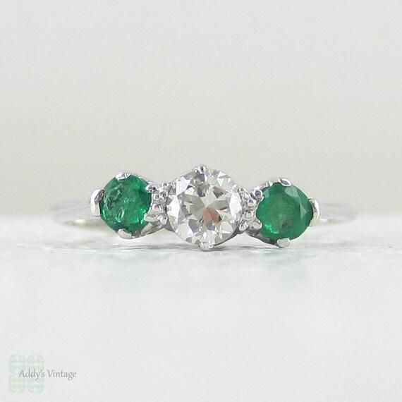 european light green emerald engagement ring