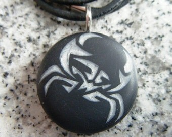 Cancer Zodiac crab signs hand carved on a polymer clay black color background.  Pendant comes with a FREE necklace.