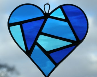 Abstract Stained Glass (Love Heart) in Blues rippling water glass