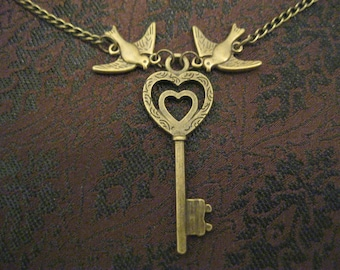 Antiqued brass key and birds necklace