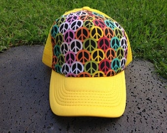 "Rainbow colored peace sign print on yellow trucker hat ""maluhia"""