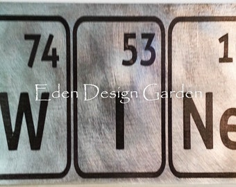 """WINe etched metal sign spelling """"Wine"""" in letters of the periodic table"""