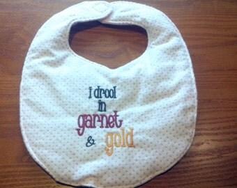 I Drool Garnet and Gold Embroidery Handmade Baby Bib On Pink Polka Dot