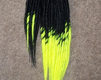 Black to Neon yellow single ended dreadlocks. Medium and short length mix