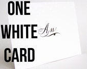 One white calligraphed card