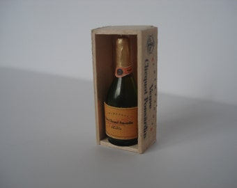 Miniature champagne glass bottle in wooden box
