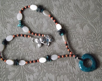 Fossil agate heart on a necklace of Mother of Pearl and Turquoise