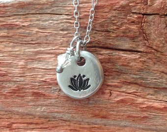 Hand stamped Lotus flower pewter pebble necklace with tiny crystal on a stainless steel chain