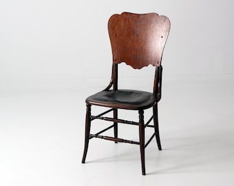 antique wood chair with leather seat