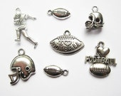 7 Football Charms / Pendants Collection - C1988