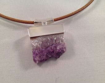 Genuine amethyst crystal slice handmade pendant In solid sterling silver.  On a leather cord.