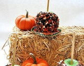 Gourmet caramel and Halloween sprinkle covered granny smith apples