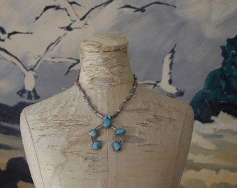 Turquoise Naja and Melon Bead Necklace. Handmade Native American Sterling Silver Jewelry.