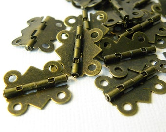 Mini bronze metal hinges