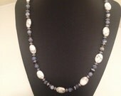 "Beautiful and classy 20"" necklace and earrings set featuring white howlite oval beads, jet cathedral beads, and sodalite beads"