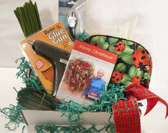 Gift Wrapped Collection includes How to make Christmas Wreath DVD, glue gun, cutters, and much more...