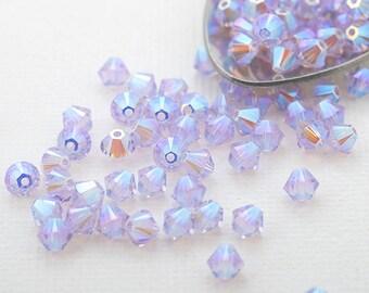 Swarovski crystals 4mm bicone beads small pkg 24 pc. violet AB2x Xilion 5328