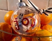 Glass ornament with shredded vintage music