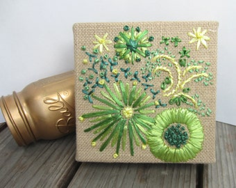 Rita's flowers. Shades of green and yellow vintage Swistraw embroidered flowers on burlap by Ruby Buffalo.