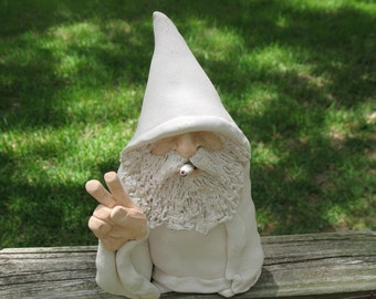 White Wizard sculpture giving Peace Sign and smoking a Hand rolled cigarette