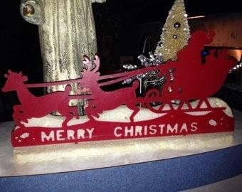 Vintage red plastic merry christmas santa claus & sleigh reindeer display