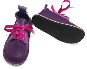 Hand made purple and pink leather and suede children's shoes.  Girls shoes