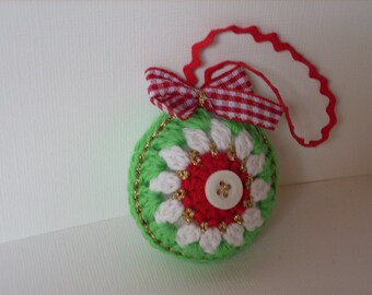 Handmade crocheted Christmas ornament in red white green