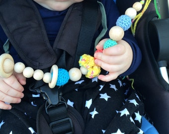 Bright multicolor stroller chain. Baby teeter. Crochet baby toy, rattle