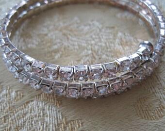 Vintage rhinestone coil bracelet.  Silver.