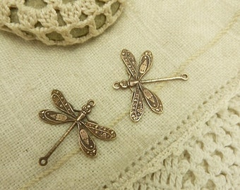 2 solid  brass stamped   brass wiht high detail  hand patina finish made in American dragon fly charms