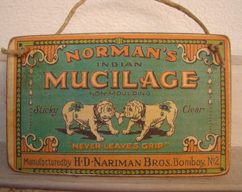Vintage advertising label  with two bulldogs, old image on wood, Victorian trading cards