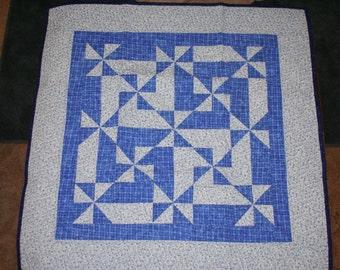 Blue pinwheel baby quilt.