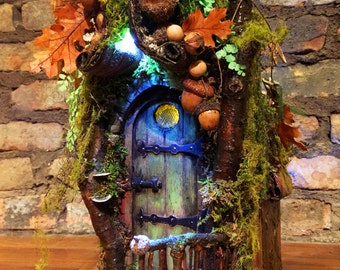 Fairy door opens into four room house with interior accessories