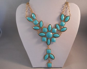 Pail Blue Bib Necklace with a Flower Design on a Gold Tone Chain