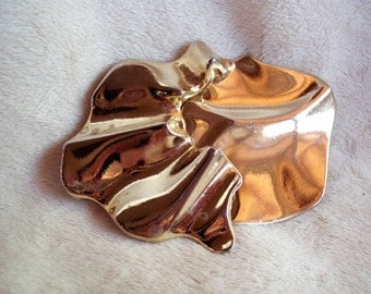 Vintage Revcor abstract goldtone belt buckle from the 1980s
