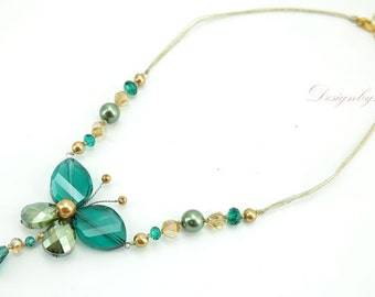 Green butterfly shell on silk necklace.