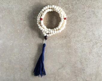 Tibetan Yak Bone Mala with Coral & Indigo Tassel