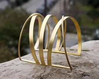 Gold cuff bracelet made of 24K gold plated brass in a beautiful geometric design. Large cuff bracelet
