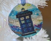 Hand painted ornament featuring Dr. Who's Tardis on a galactic blue background