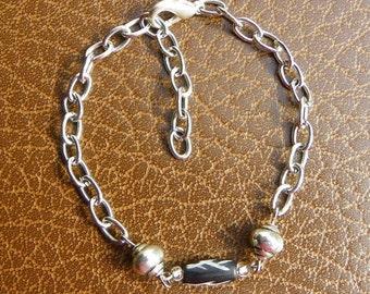 "Simple Silver Tone Bracelet 7"" extends to 9"""