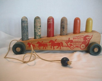 1930's Holgate wooden pull toy, pegs
