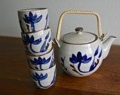 Vintage ceramic tea set with 4 cups