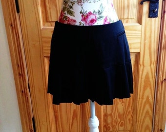 Classic Black 90's pleated mini skirt in a UK size 12 / USA size 8 .