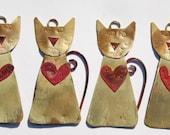 Little handmade metalwork cat with heart decoration